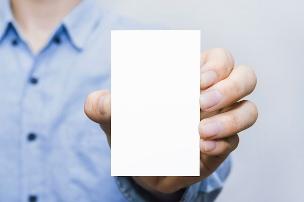 Card paper held by hand of businessman casual style