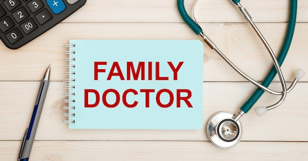 Card with text family doctor and stethoscope