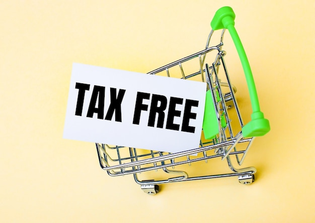 The card with the word tax free is in the shopping cart. marketing concept.