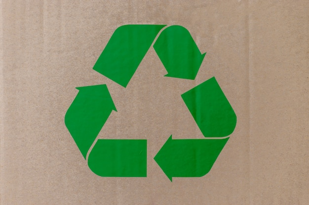 Cardboard box background with green recycle symbol for recycling concept. world environment day.