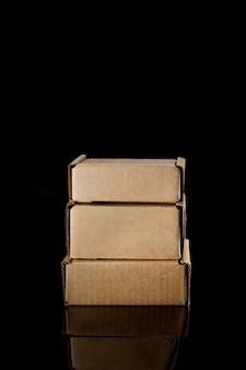 Cardboard box d on black.