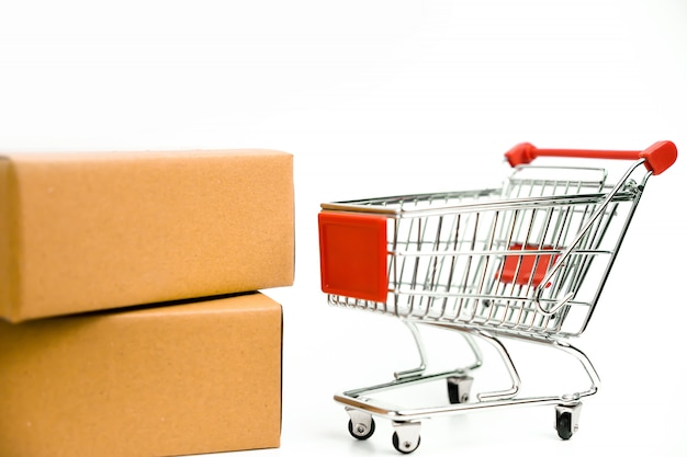 Cardboard box and trolley cart on isolated white background