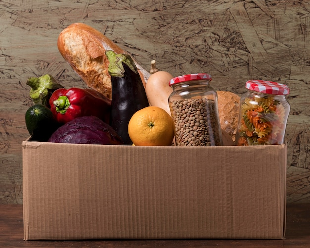 Cardboard box with vegetables and fruits