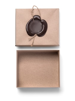 Cardboard box with wax seal isolated on white with clipping path