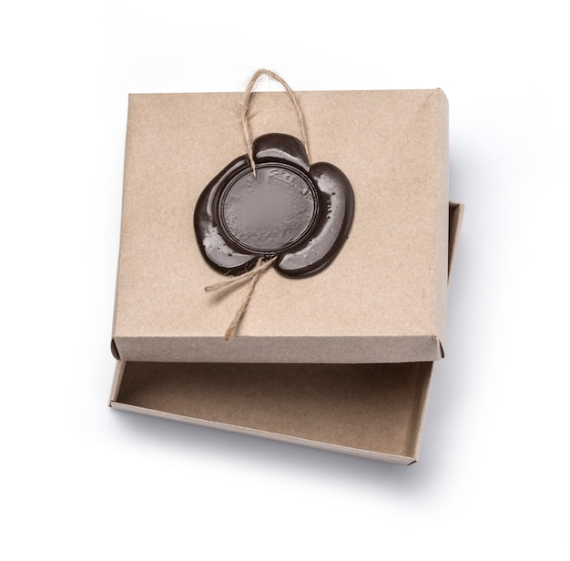 Cardboard box with wax seal isolated on white