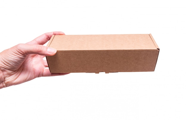 Cardboard box in woman hand, isolated