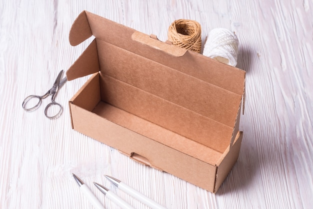 Cardboard box on wooden table