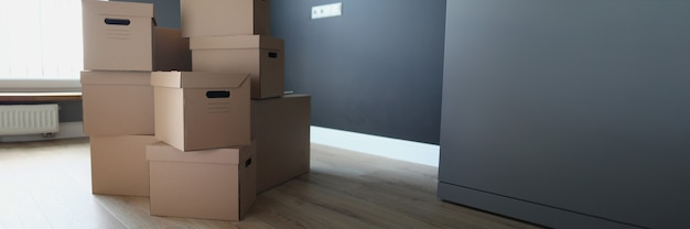 Cardboard boxes in empty room. services of transport and logistics company