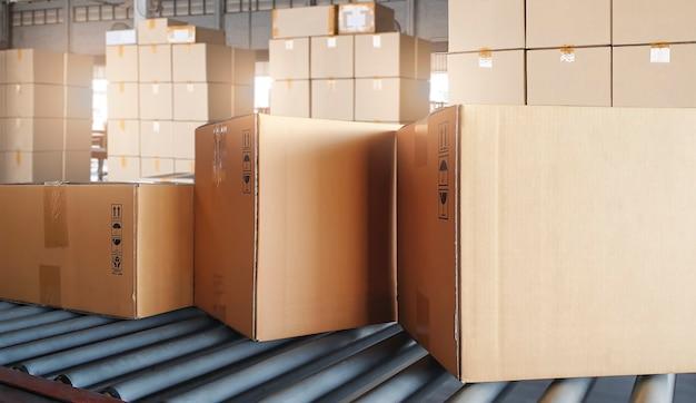 Cardboard boxes sorting on rollers conveyor belt.
