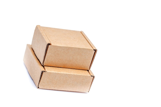 Cardboard boxes of various sizes isolated on white background.