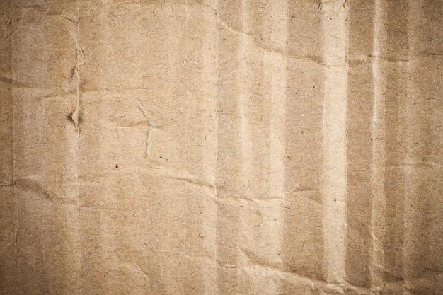 段ボール茶色の紙の背景のビネット。
