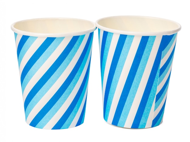 Cardboard cups decorated with blue lines pattern isolated on white background