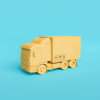 Cardboard delivery truck with package on top
