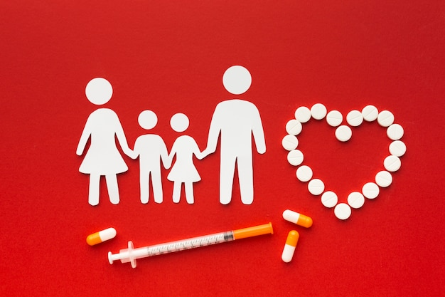 Cardboard family shapes with drugs and syringe