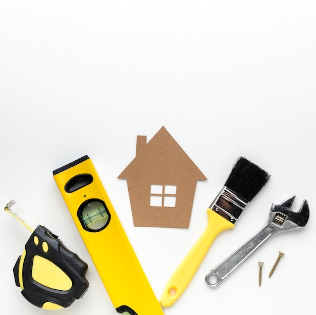 Cardboard house and repair tools with copy space