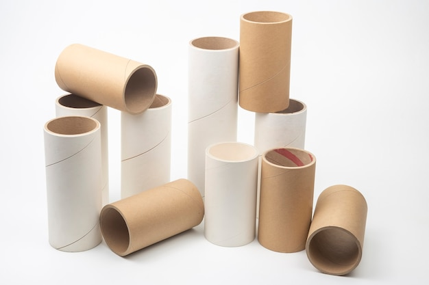 Cardboard and paper tubes and pipes on a white