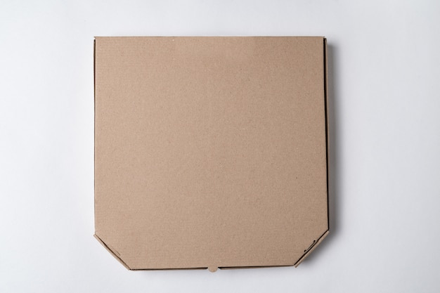 Cardboard pizza box on white background. mockup, place for text.