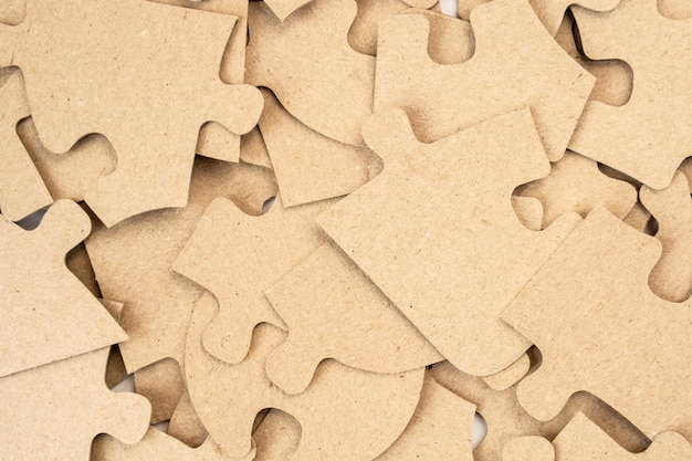 Cardboard puzzles as a background close up.