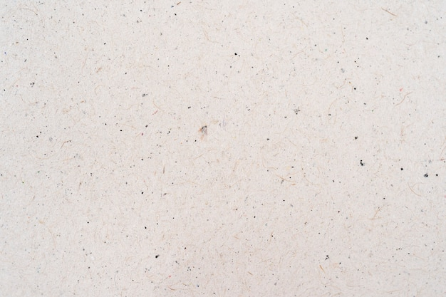 Cardboard sheet of paper close up. white craft paper texture background. top view cardboard