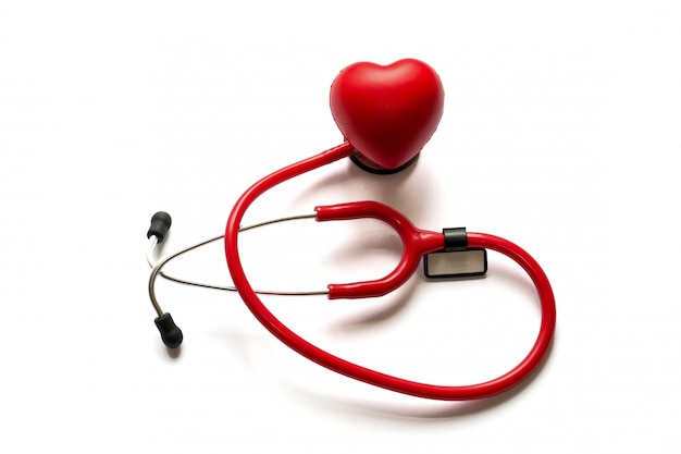 Cardiology. medicine close up red stethoscope and heart isolated on background. copy space