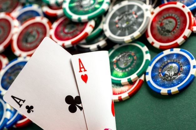 Cards and chips for poker on green table