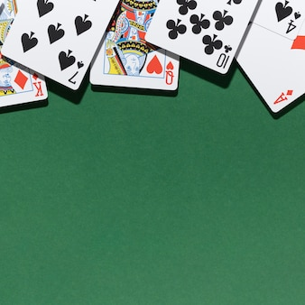Cards on green background