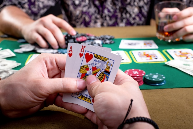 Cards in male hands on the space