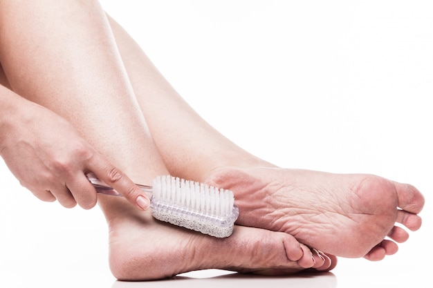 Care for dry skin on the well-groomed feet and heels