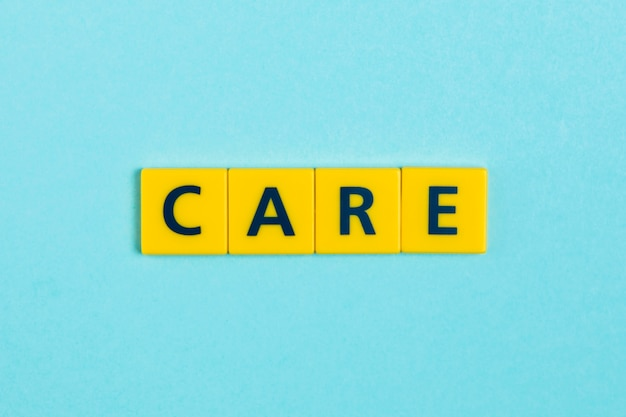 Care word on scrabble tiles