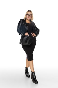Carefree. beautiful young womanin black outfit isolated