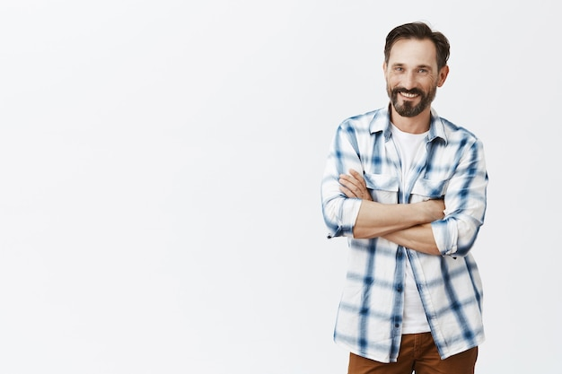 Carefree handsome bearded mature man laughing and smiling