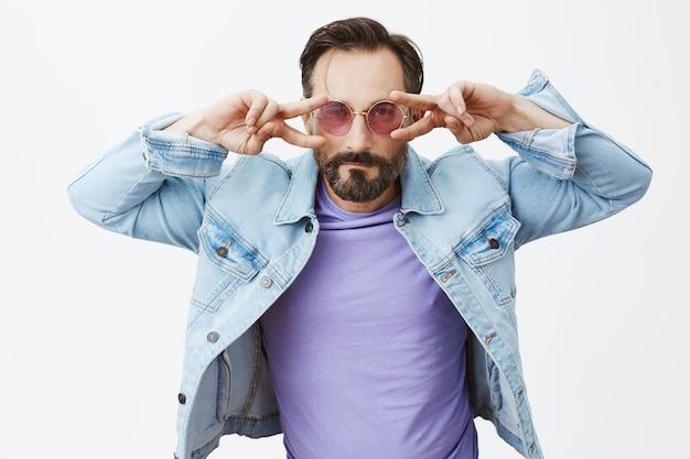 Carefree handsome bearded mature man posing