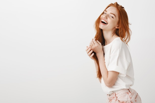 Carefree happy redhead woman laughing and smiling, enjoying summer