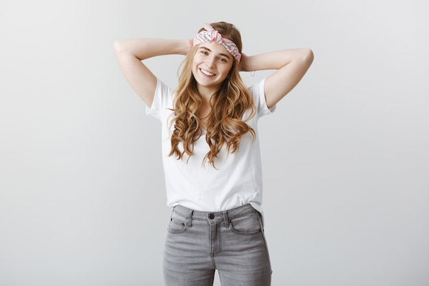 Carefree stylish blond girl enjoying summer, looking happy