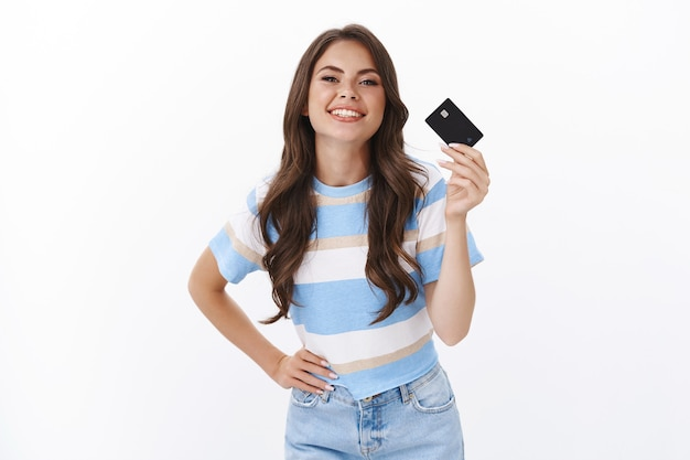 Carefree unbothered good-looking stylish woman like paying credict card, smiling joyfully recommend open bank account, give card to make purchase