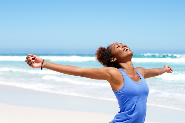 Carefree woman having a good time at beach