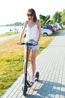 Carefree woman riding a scooter