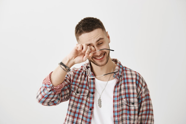 Carefree young guy with glasses posing