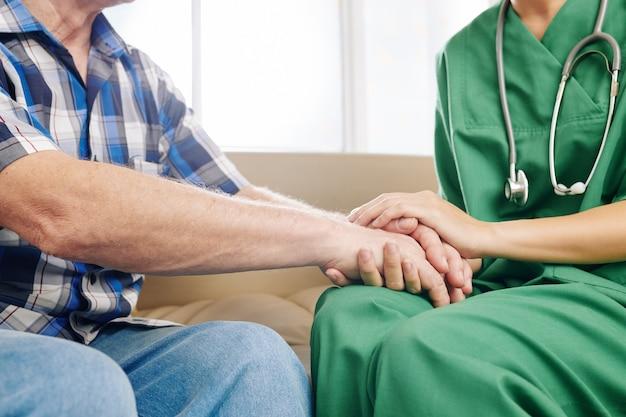 Caregiver comforting patient