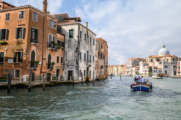 Cargo boat on the grand canal. the historical center of venice.