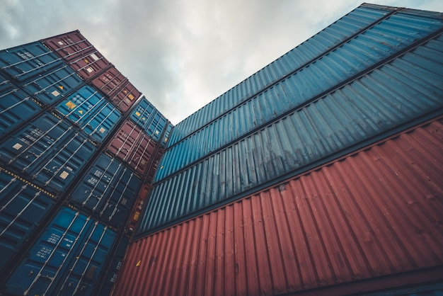 Cargo container for overseas shipping on high stack look up from ground