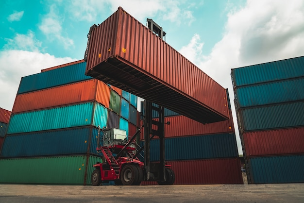 Cargo container for overseas shipping in shipyard with heavy machine .