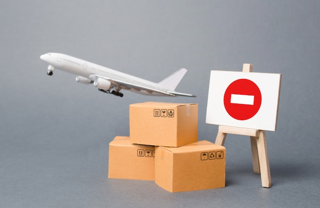Cargo plane with boxes and an easel with a restriction sign. restrictions on export medical goods