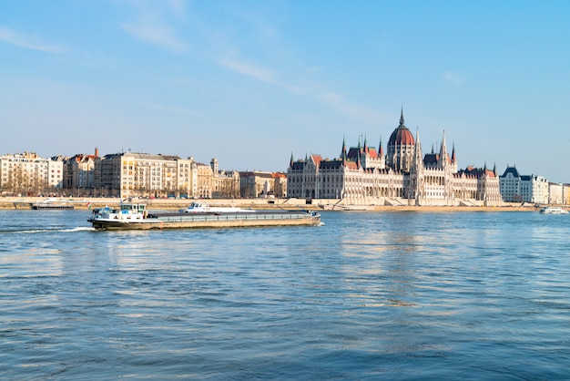 Cargo ship passes parliament building in central budapest