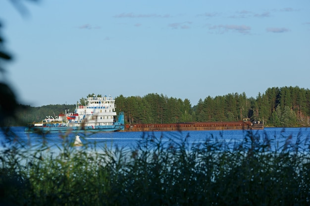 Cargo ship on the river in russia.