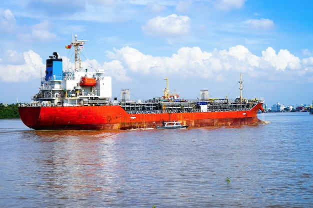 Cargo ship at river of thailand in asia, logistics, transportation and shipping.