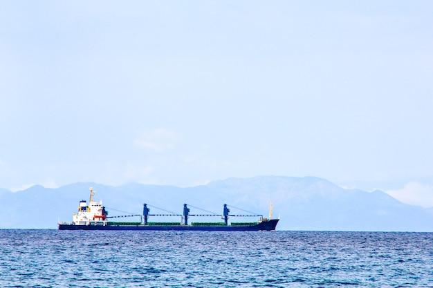 Cargo ship sailing on sea