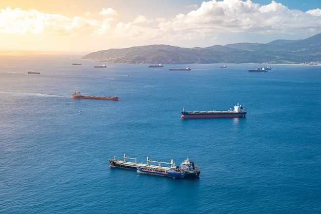 Cargo ships with containers, goods are transported via sea