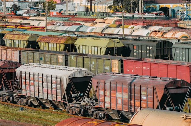 Cargo train cars wagons platform with container.