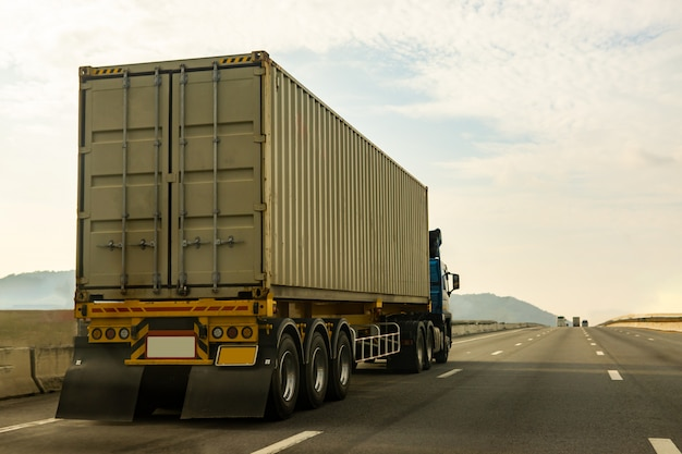 Cargo truck on highway road with container, logistic industrial transporting land transport